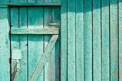 Green wooden door with part of fence copyspace Royalty Free Stock Image