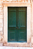 Green wooden doors in Dubrovnik, Croatia Stock Image