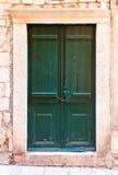 Green wooden doors in Dubrovnik, Croatia stock image