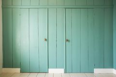 Green wooden doors in a vintage home. Cozy Royalty Free Stock Photos