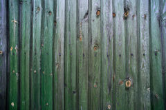 Green wooden fence of boards Royalty Free Stock Image