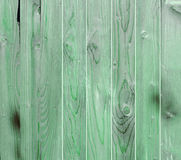 Green wooden fence, close up, texture, background. Natural wood. Vertical bars Stock Photo