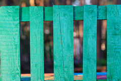 Green wooden fence in the village Stock Images
