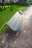 Green wooden garden bench in Paris Stock Photo