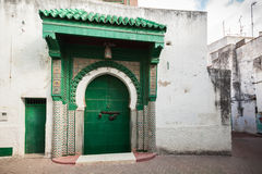 Green wooden gate of ancient mosque Morocco Stock Photo