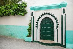 Green wooden gate of ancient mosque in Tangier Royalty Free Stock Photo