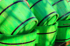 Green wooden half barrels for use in a garden. Vived green wooden garden half barrels for patio planting.  Piled in a row Royalty Free Stock Photos