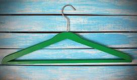 Green wooden hanger Stock Images