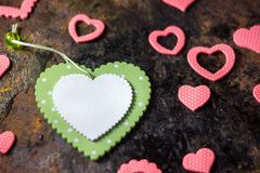 Green wooden heart and pink hearts. Valentine's day background. Green wooden heart and pink hearts. Valentine's day background stock photos