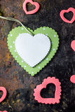 Green wooden heart and pink hearts. Valentine's day background. Royalty Free Stock Photography