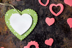 Green wooden heart and pink hearts. Valentine's day background. Royalty Free Stock Image