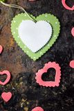 Green wooden heart and pink hearts. Valentine`s day background. Green wooden heart and pink hearts. Valentine`s day background Stock Image