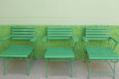 Green wooden park bench in the public park are nobody. Stock Images