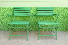 Green wooden park bench in the public park are nobody. Stock Photos