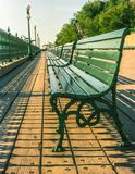 Green Wooden Park Benches in row on Boardwalk, Quebec City, Canada stock image