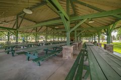Free Green Wooden Picnic Tables And Benches Inside The Pavilion Of A Park Royalty Free Stock Images - 155078629