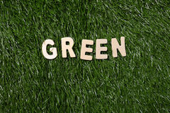 Green Wooden Sign On Grass Stock Images