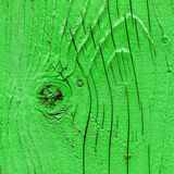 Green wooden surface with knot, background texture Stock Image