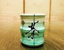 A green wooden tea cup Stock Photo