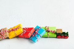 Green wooden train haul Christmas colorful gifts on white background. Copy space royalty free stock photo