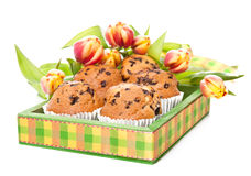 Green wooden tray with muffins and bunch of tulips royalty free stock photos