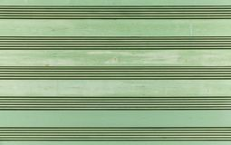 Green wooden wall, frontal background royalty free stock photo