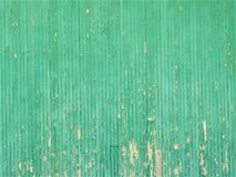 Green Wooden Wall of an old abandoned building / paint chipping royalty free stock image