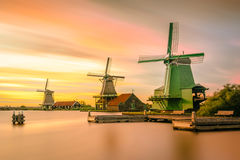 Green Wooden Wind Mill Near Brown Wooden Jetty during Sunset Royalty Free Stock Image