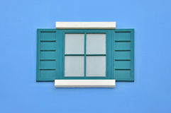 Green wooden window on blue wall Royalty Free Stock Photography