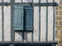 Green wooden window closed on a wall with wooden beams. Royalty Free Stock Image