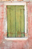 Green wooden window cover of an old house Royalty Free Stock Photos