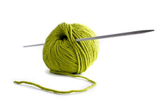 Green wool and needle Royalty Free Stock Photo