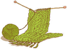 Green wool scarf and hank of yarn Royalty Free Stock Photography