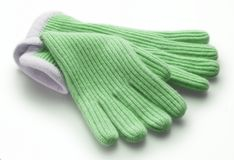 Green woolen gloves Stock Images
