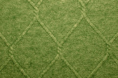 A Green woolen texture. Rhombus Royalty Free Stock Photography