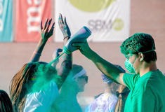 Green workers in a color run race Stock Image