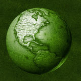 Green world. Green floating globe against a grassy background Royalty Free Stock Images