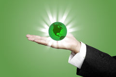 Green World with Business Hand concept Stock Image