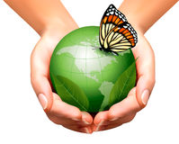 Green world with leaf and butterfly in woman hands. Royalty Free Stock Photo
