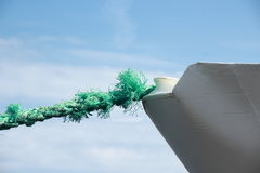 Green worn anchor rope on ship bow Royalty Free Stock Photography