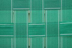 Green woven lawn chair webbing Royalty Free Stock Image