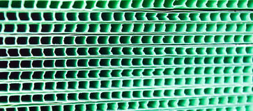 Green woven metallic grunge grid striped abstract background Stock Images