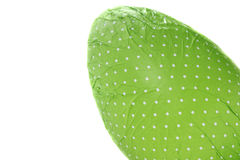 Green wrapped Easter Egg from corner stock photo