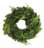 Green wreath. Green christmas wreath isolated over white background royalty free stock photography