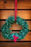 Green wreath hanging Stock Photo
