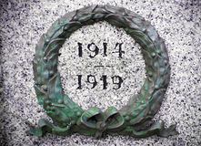 Green wreath on war memorial. With the years 1914 and 1919 and stock photo