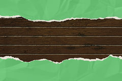 Green wrinkled paper ripped on the wooden board. Stock Photography