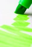 Green writing textmarker. Closeup macro writing green marker on white paper Stock Photos