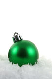 Green Xmas Bauble in the Snow Stock Photos