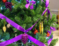 Green xmas tree with purple knot. And accessories Royalty Free Stock Images